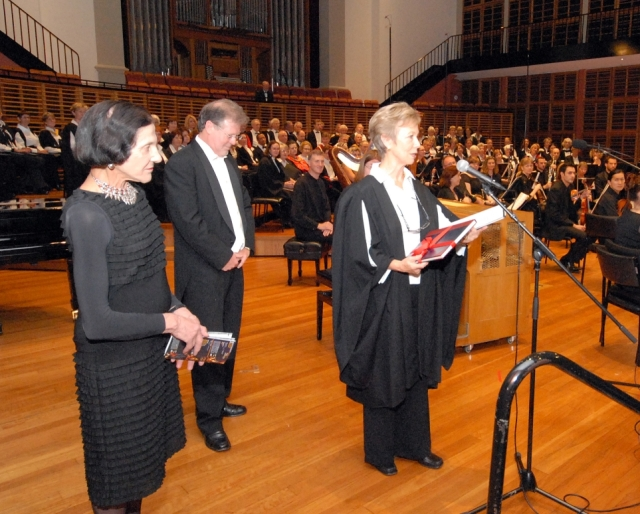 As President, Marilyn presents a bound copy of the score of 'Songs of the Heart' to Patron, HE Professor Marie Bashir