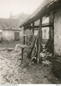 Flesselles, France November 1916. 'Catching up with Correspondence'. Image E00030 Australian War Memorial