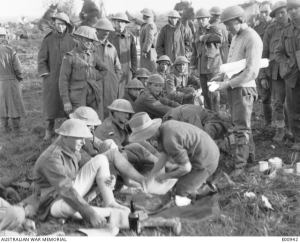 Members of the 40th Battalion, taking steps to address the problem of 'trench feet', after the Battle of Passchendaele, 1917 – Australian War Memorial E00942