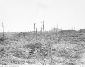 Stretcher bearers of the 57th Battalion, passing through the cemetery near the mound in Polygon Wood in the Ypres Sector. 28 September 1917. Photo: Unknown Australian Official Photographer. Image: Australian War Memorial E01912